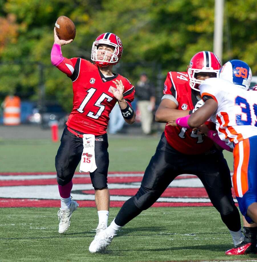 New Canaan's Nick Cascione throws a pass during Saturday's football game at New Canaan High School on October 12, 2013. Photo: Lindsay Perry