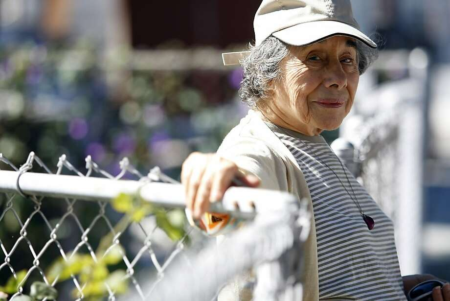 Lupe Quinones, 81, has suffered cuts and bruises after tripping while on walks in her San Mateo County neighborhood. Photo: Michael Short, Special To The Chronicle