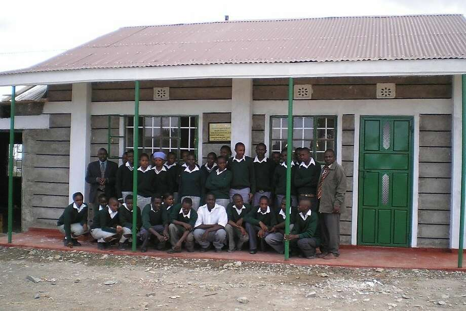 One Dollar for Life builds schools and donates needed items in impov- erished parts of the world. Photo: Courtesy Of Robert Freeman