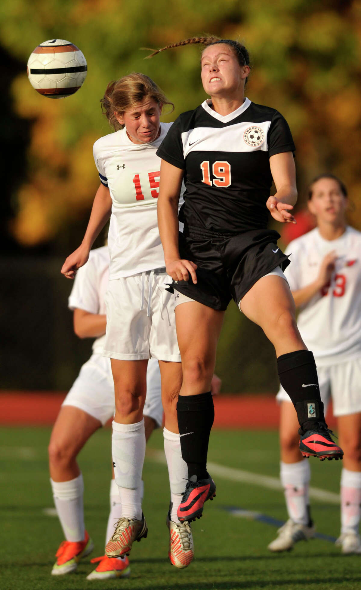 Greenwich's Elizabeth Warner and Ridgefield's Liane Keegans compete for the header during their game at Greenwich High School in Greenwich, Conn., on Monday, Oct. 14, 2013. The game ended in a 1-1 tie.