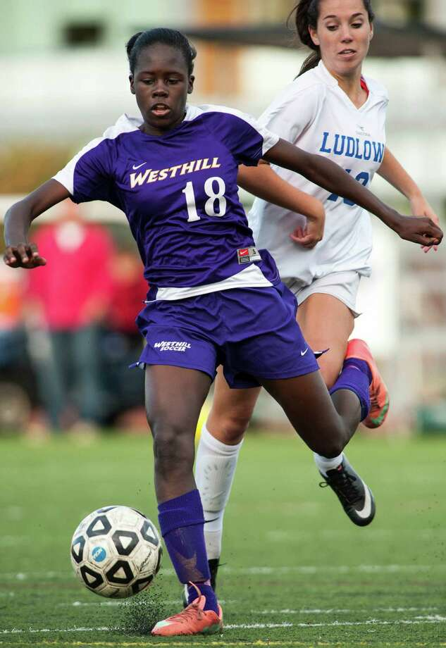 Westhill high school's Chelsea Domond and Fairfield Ludlowe high school's Annie McNamara battle for the ball during a girls soccer game played at Ludlowe high school, Fairfield, CT on Monday, October, 14th, 2013. Photo: Mark Conrad / Stamford Advocate Freelance