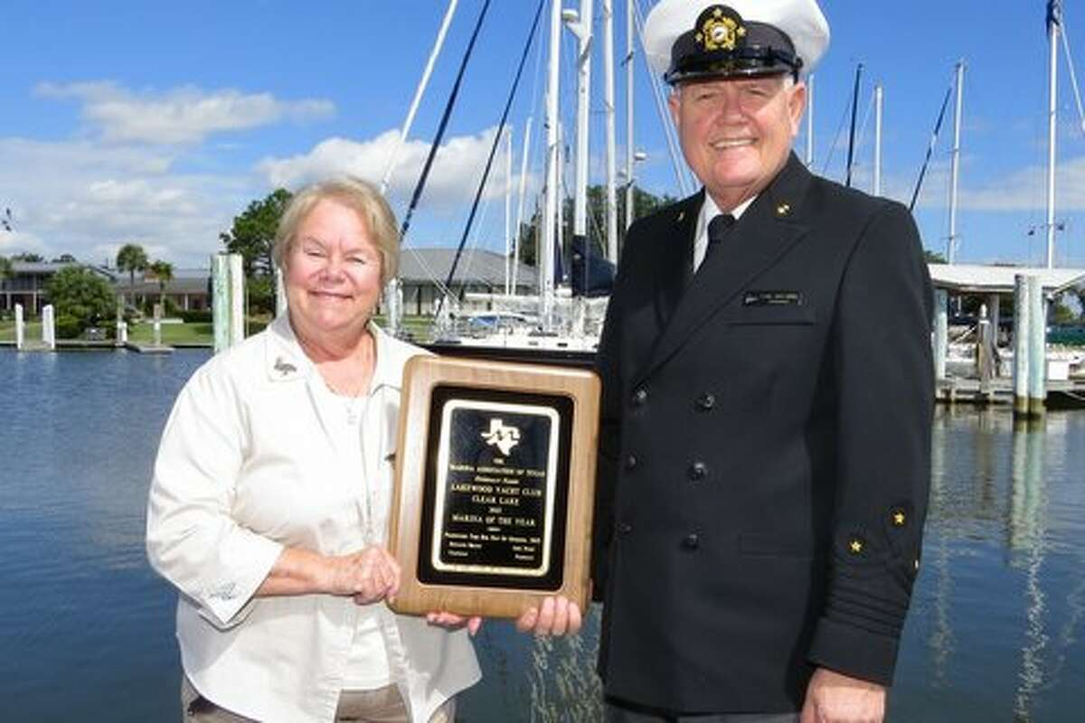 Harbor administrator Lynda Hall and Lakewood Yacht Club Commodore Carl Drechsel hold the Marina of the Year Award.