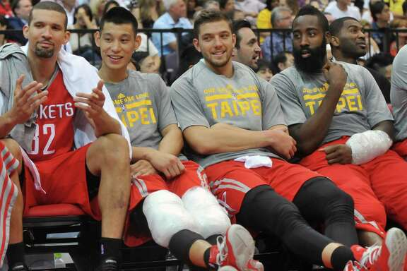 Rockets Francisco Garcia, from left, Jeremy Lin, Chandler Parsons and James Harden have two weeks to prepare for the season after traveling halfway around the world.