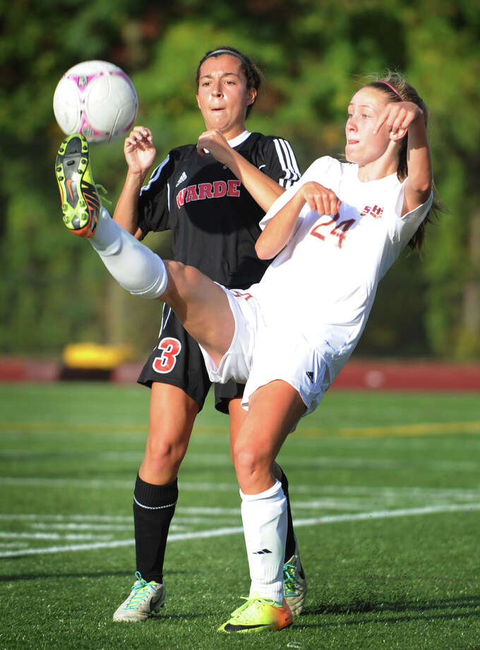 Fairfield Warde's Sarah Reilly, left, defends St. Joseph's Lindsey Savko during their FCIAC girls soccer match at St. Joseph High School in Trumbull on Monday, October 14, 2013. Photo: Brian A. Pounds / Connecticut Post
