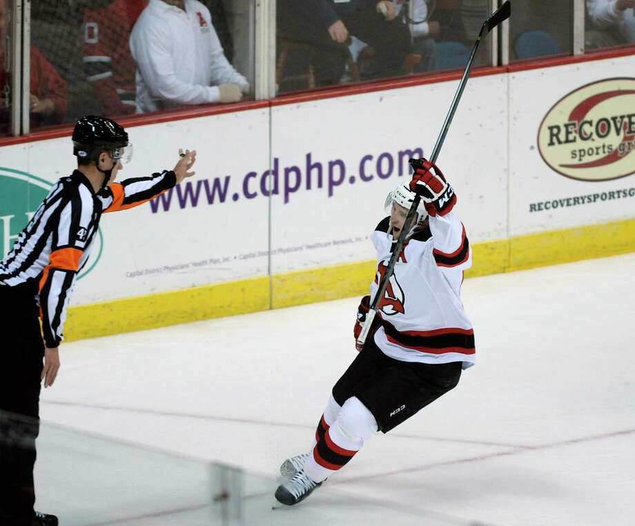 Albany's Tim Sestito celebrates his goal on a penalty shot during the first period of the Albany Devils and Adirondack Phantoms hockey game at the Times Union Center on Monday, Oct. 14, 2013 in Albany, NY.   (Paul Buckowski / Times Union) Photo: Paul Buckowski / 00024246A