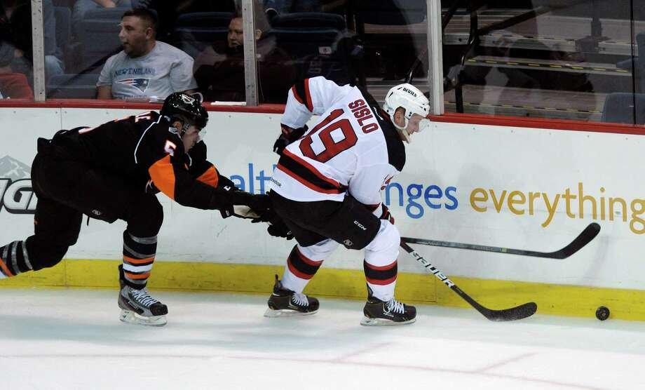 Albany's Steven Delisle, left, tries to knock the puck away from Albany's Mike Sislo during the first period of the Albany Devils and Adirondack Phantoms hockey game at the Times Union Center on Monday, Oct. 14, 2013 in Albany, NY. Photo: Paul Buckowski / 00024246A