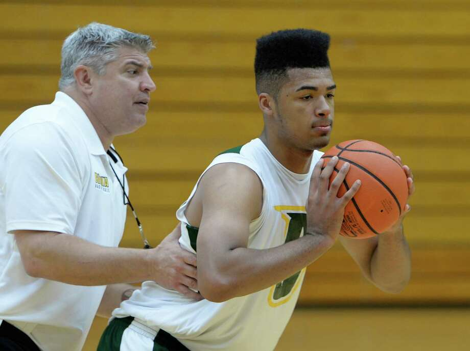 Javion Ogunyemi works out with coach Jimmy Patsos during Siena Men's basketball practice Oct. 10, 2013 in Loudonville, N.Y.        (Skip Dickstein / Times Union) Photo: Skip Dickstein / 00024226A