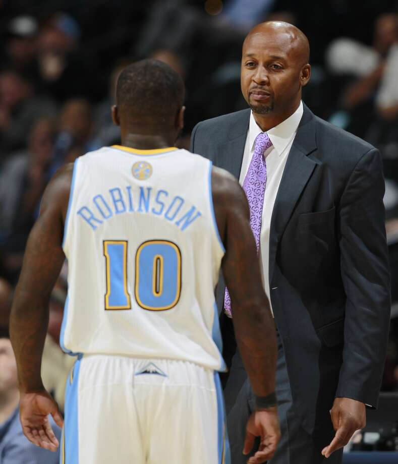 Denver Nuggets head coach Brian Shaw, back, confers with guard Nate Robinson while facing San Antonio Spurs in the fourth quarter of the Nuggets' 98-94 victory in an NBA preseason basketball game in Denver on Monday, Oct. 14, 2013. (AP Photo/David Zalubowski) Photo: Associated Press