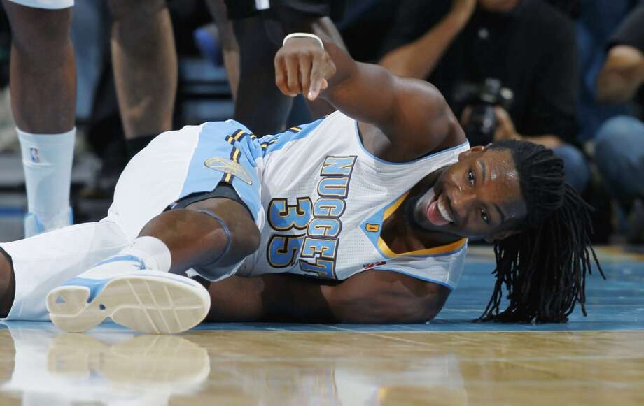 Denver Nuggets forward Kenneth Faried reacts after making an off-balance basket against the San Antonio Spurs in the fourth quarter of the Nuggets' 98-94 victory in an NBA preseason basketball game in Denver on Monday, Oct. 14, 2013. (AP Photo/David Zalubowski) Photo: Associated Press