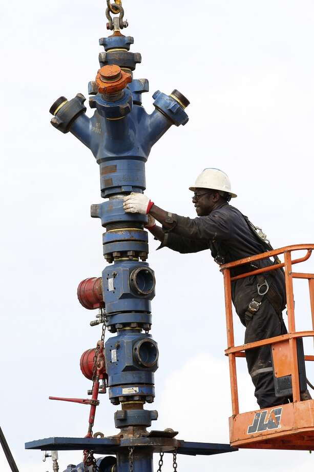 Nathen George removes a frac tree from a well on a ranch southwest of Ben Bolt, Texas. The well, located near the Jim Wells and Duvall County line, was drilled to a depth of over one mile. Photo: Jerry Lara, San Antonio Express-News