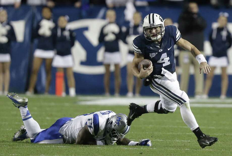 BYU's Taysom Hill is the top rushing quarterback in the nation. Photo: Rick Bowmer, Associated Press / AP