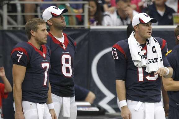 Texans quarterbacks Case Keenum, Matt Schaub and T.J. Yates stand on the sidelines during a preseason game.