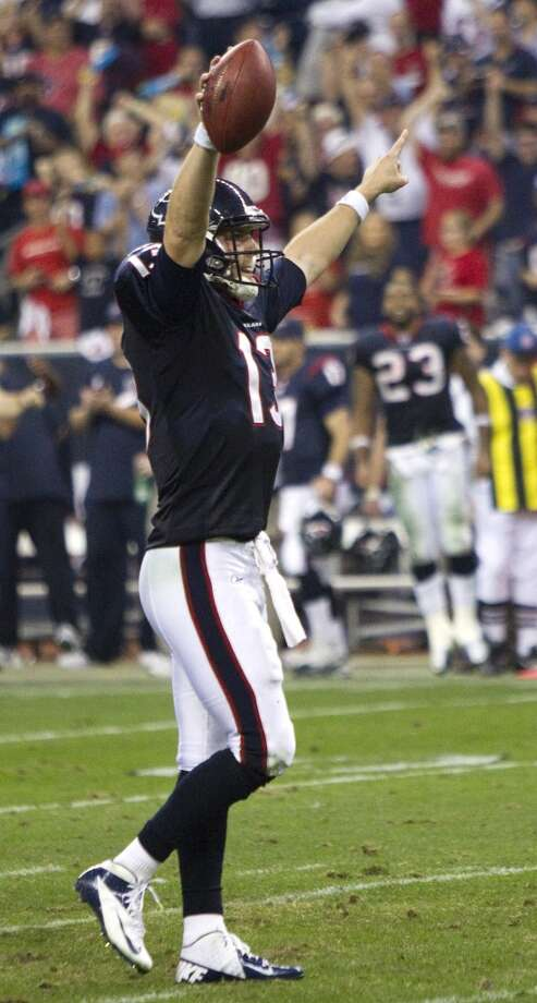 Texans quarterback T.J. Yates celebrates a playoff victory against the Bengals. Photo: Brett Coomer, Houston Chronicle