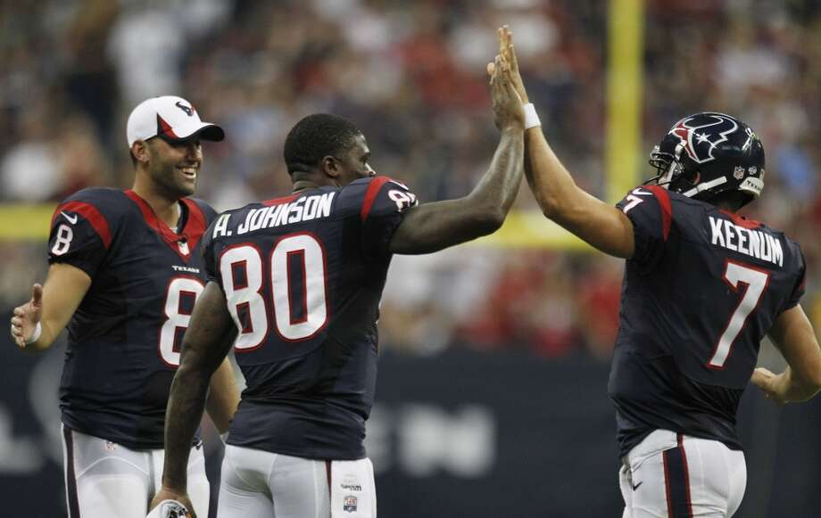 Case Keenum is congratulated by Texans' teammates Andre Johnson and Matt Schaub during preseason action. Photo: Brett Coomer, Houston Chronicle