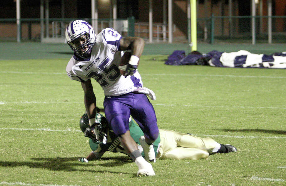 Newton's Brandon Johnson (No. 25) escapes a tackle during the 43-24 win over East Chambers last Friday at Buccaneer Stadium in Winnie, TX. The senior rushed for 294 yards and three touchdowns on 15 carries, as Kevin Shorter was carted off the field with an injury in the second quarter. (Matt Billiot / Special to the Enterprise) Photo: Matt Billiot / Copyright Matt Billiot