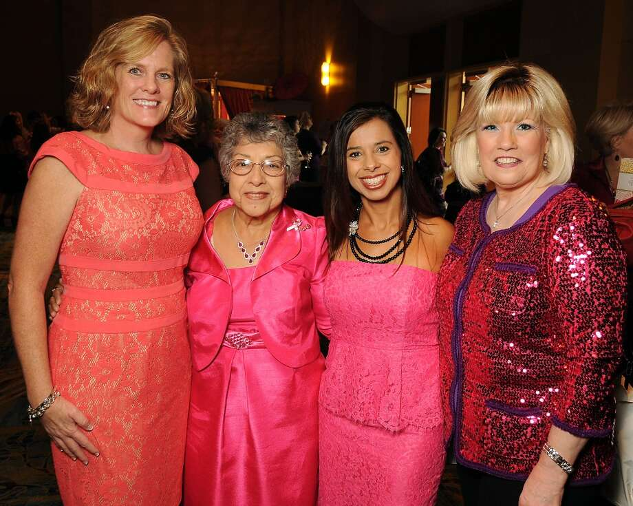 "From left: Sheri Fogarty, Juanita Edgerton, Beverly Mills and Lorelie Metcalf at the 13th annual ""The Pink of Health"" luncheon benefitting Memorial Hermann at the Woodlands Waterway Marriott Friday Oct. 11,2013.(Dave Rossman photo) Photo: For The Houston Chronicle"