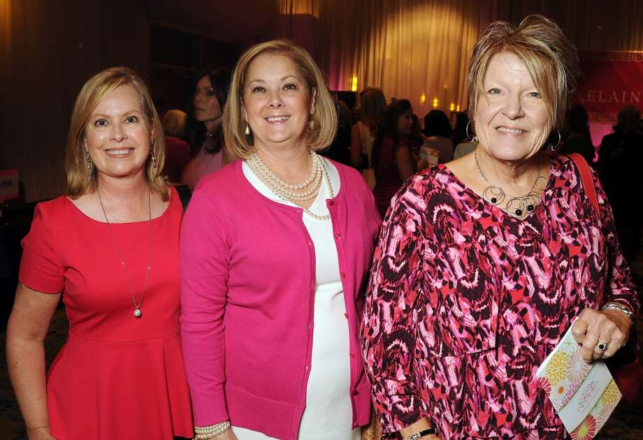 "From left: Kristy Defenbaugh, Anita Phillips and Penny Powers at the 13th annual ""The Pink of Health"" luncheon benefitting Memorial Hermann at the Woodlands Waterway Marriott Friday Oct. 11,2013.(Dave Rossman photo) Photo: For The Houston Chronicle"