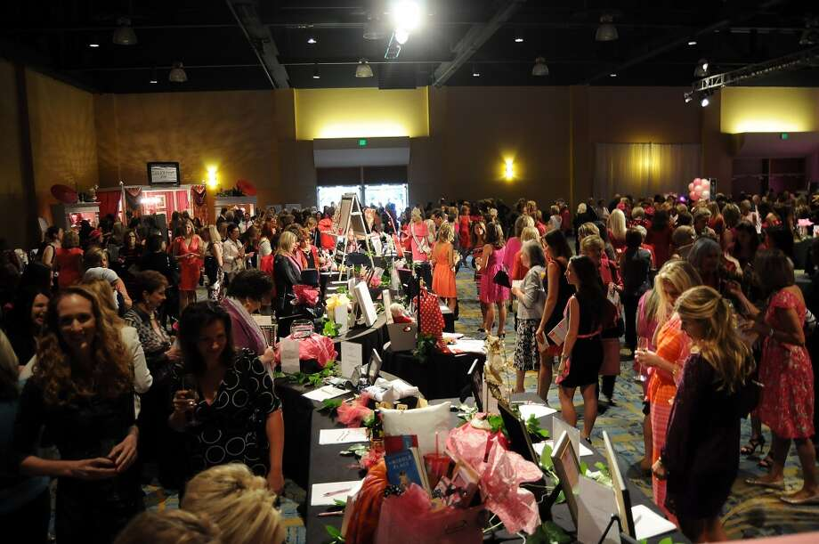 """Guests browse the vendor tables at the 13th annual """"The Pink of Health"""" luncheon benefitting Memorial Hermann at the Woodlands Waterway Marriott Friday Oct. 11,2013.(Dave Rossman photo) Photo: For The Houston Chronicle"""
