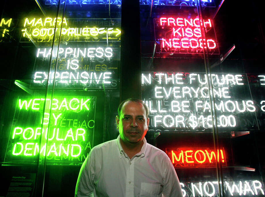 Artist Alejandro Diaz with some of his neon sign art Friday July 11, 2008 at SoHo Wine & Martini Bar.  Photo: EDWARD A. ORNELAS, SAN ANTONIO EXPRESS-NEWS / eornelas@express-news.net