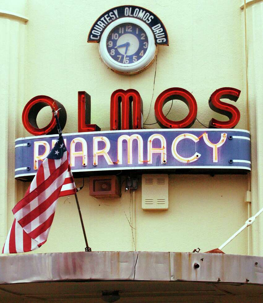 Neon lights the signage of the Olmos Bharmacy located at the corner of Hildebrand Road and McCullough Avenue.