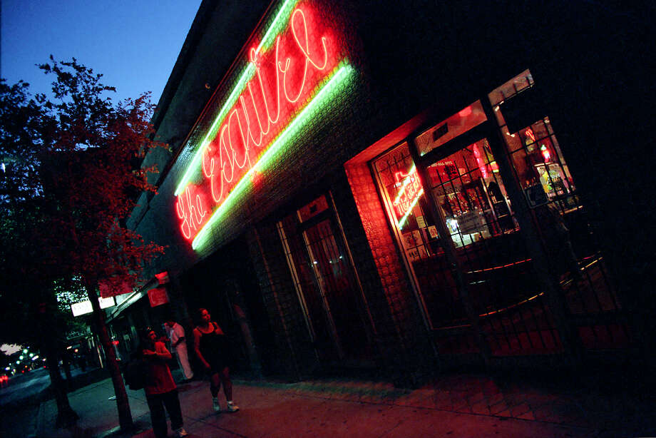 On West Commerce Street, The Esquire's neon signature glows above the entrance to one of San Antonio's oldest and most famous bars.  Photo: MIKE GREENBERG, SAN ANTONIO EXPRESS-NEWS / SAN ANTONIO EXPRESS-NEWS