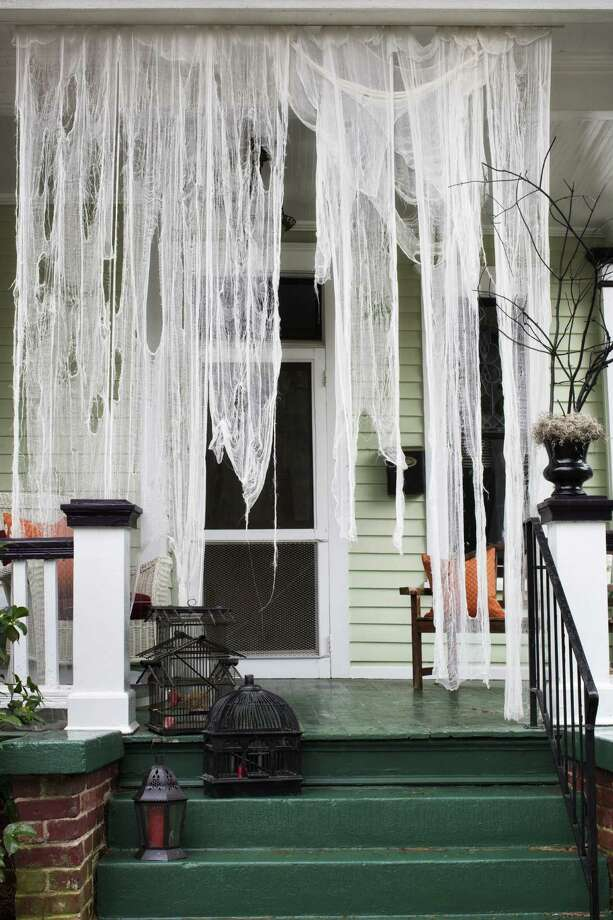 Ripped pieces of cheesecloth soaked in weak tea set the mood at the front door. Photo: Sarah Dorio / Scripps Networks Interactive