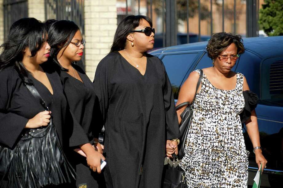 Mourners, including Miriam Carey's sister, Valarie Carey, second from right, enter Grace Funeral Chapels in Brooklyn, N.Y., on Tuesday, October 15, 2013, where the funeral for Miriam Carey was held. Photo: Lindsay Perry / Stamford Advocate