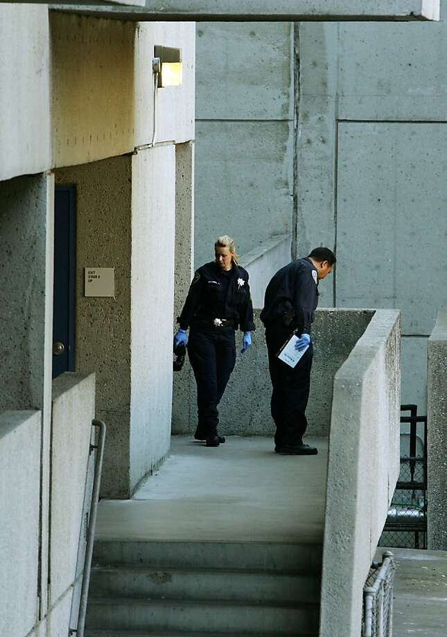 In this photo made Tuesday Oct. 8, 2013, investigators are seen in the stairwell of San Francisco General Hospital where the body of Lynne Spalding was foundin San Francisco, Calif. Family and friends of the patient who disappeared from her room only to be found dead in a hospital stairwell more than two weeks later demanded answers from authorities and medical officials, who said they, too, were horrified at what happened to the 57-year-old woman.   (AP Photo/San Francisco Examiner, Mike Koozmin) Photo: Mike Koozmin, Associated Press