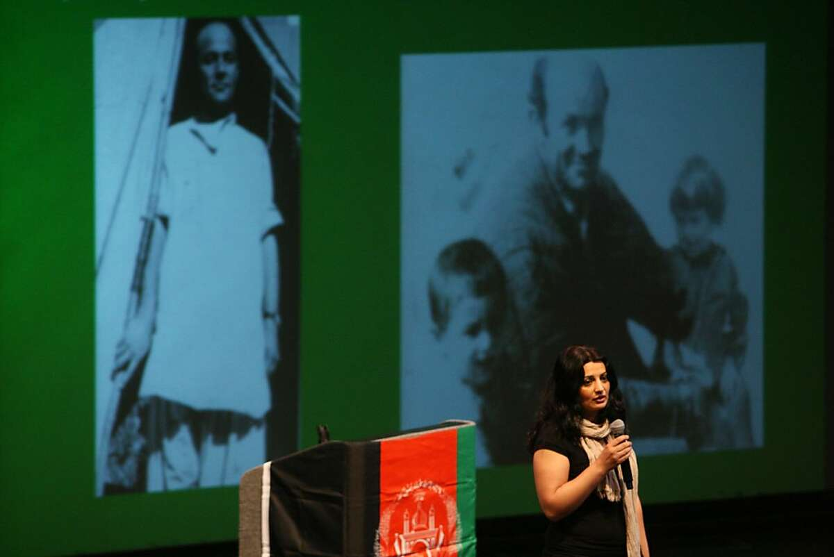 Asma Salehi speaks about her father, whose name was included on recently released list of deceased Afghans during the 5000 Open Wounds event at the Cal State East Bay campus, in Hayward, Calif. on Sunday, Oct. 13, 2013.