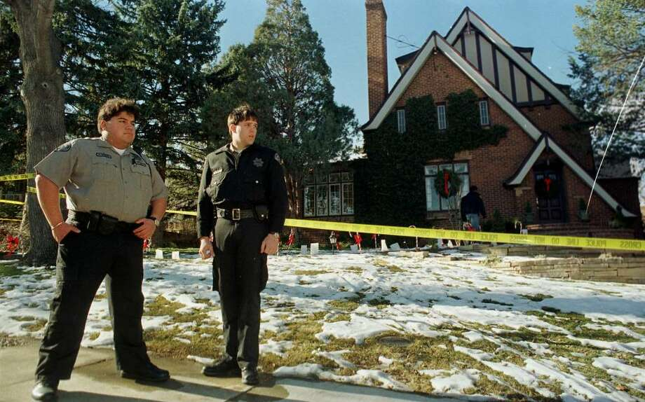 Cadets from the Boulder, Colo., Sheriff's Department Val Montez, left, and Eric Hill stand guard along the crime scene tape stretched around the home in which 6-year-old JonBenet Ramsey was found dead on Christmas Day 1996 in this file photograph taken on Dec. 27, 1996, in Boulder, Colo Photo: DAVID ZALUBOWSKI, AP / AP