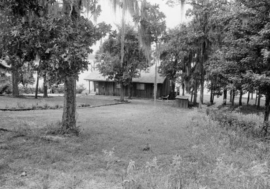This cabin near Lake Sam Rayburn in Broaddus, Texas, is owned by the family of Dean Corll, 33, the alleged central figure in 1973 a mass slaying case. Sheriff's deputies searched the cabin and found torture items inside the cabin and under it. (AP Photo)