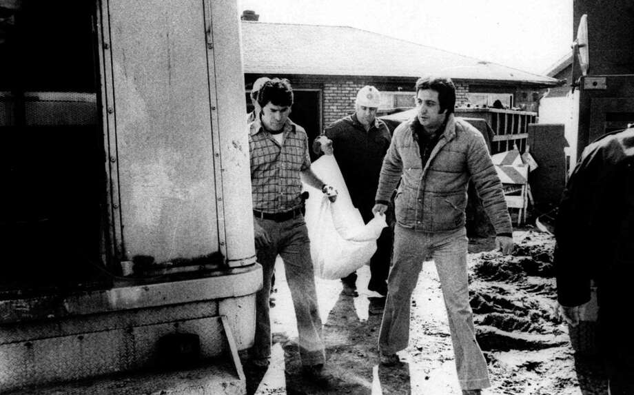 Cook County sheriff's police remove the remains of another body found March 17, 1979, at the Chicago suburban home of accused murderer John W. Gacy. Photo: AP
