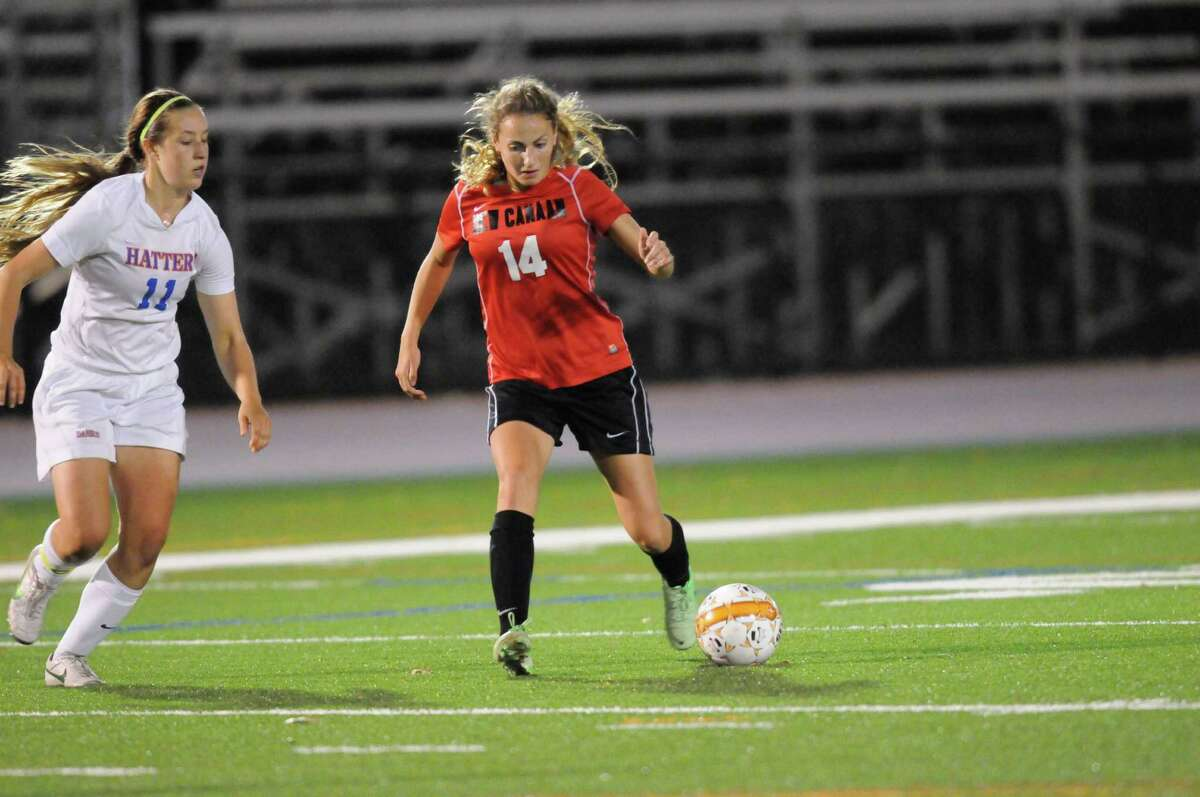 New Canaan's Marina Braccio (No. 14) charges down the field during Danbury's 2-1 win at Danbury High School on Monday, Oct. 14, 2013. By Dave Crandall