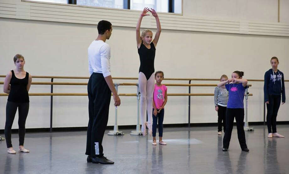 Darien resident Tess Keating executes a perfect saute (jump) from first position for Silas Farley at the New York City Ballet studios. Photo: Contributed Photo, Contributed / Darien News