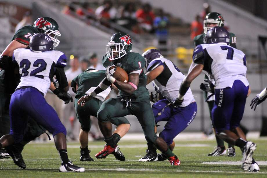 The Woodlands running back Patrick Carr (1) ran for 196 yards and one touchdown against Allen, giving him 1,397 yards and 15 touchdowns on the year. Photo: Jerry Baker, Freelance