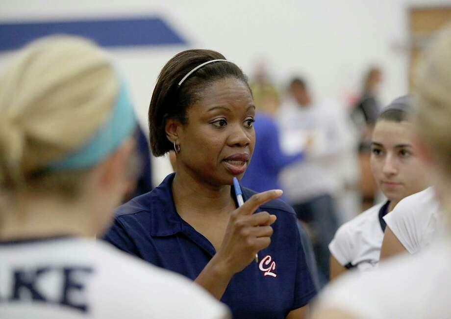8/13/13: Clear Lake Falcons head coach Chanda Eager talks to her team before game 5 against the Friendswood Mustangs  in a high school volleyball match at Clear Lake High School in Houston, Texas. Photo: Thomas B. Shea, Freelance / © 2013 Thomas B. Shea