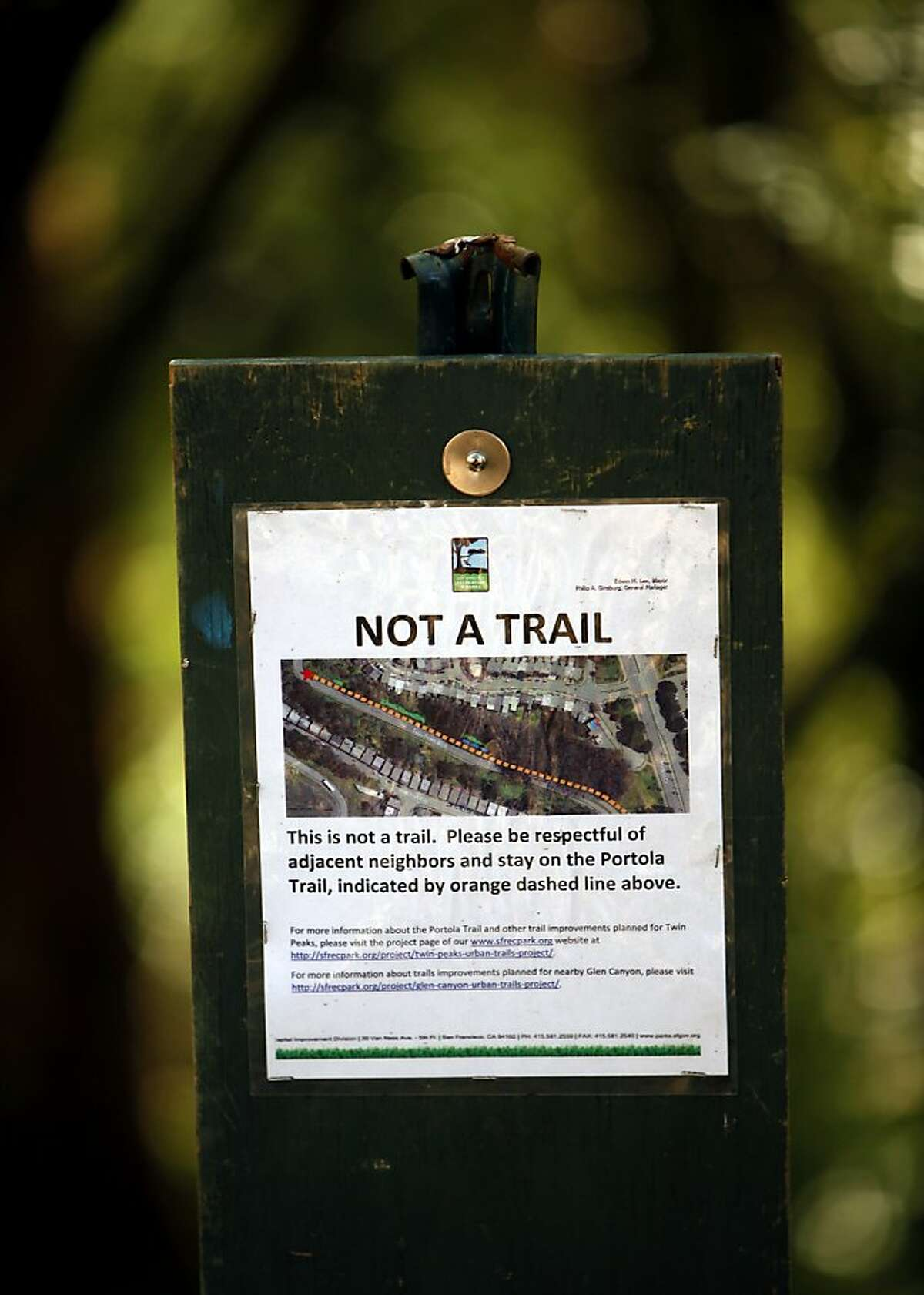 A sign warns hikers off old trails and onto the new San Francisco Recreation and Parks trail that leads up Twin Peaks Boulevard in San Francisco, Calif., on Thursday, October 10, 2013.