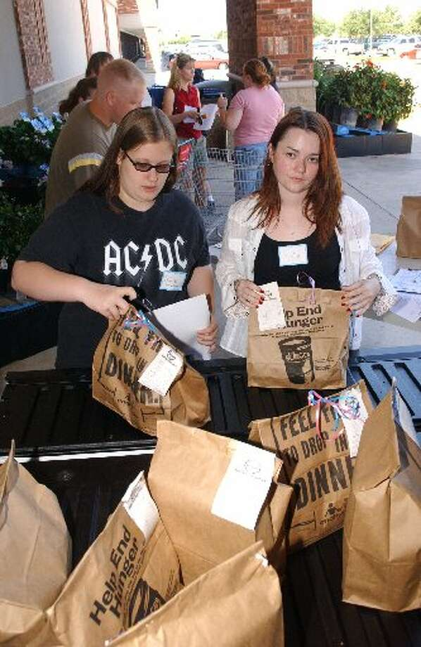 Volunteers work on a food drive for the Bay Area Turning Point. This year's food drive will be Nov. 15-16 at area Kroger stores. Volunteers are needed to help.