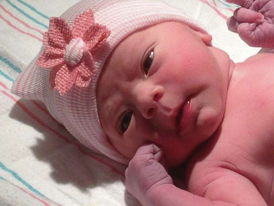 "Fox 26's Sally MacDonald gave birth to her daughter Megan Joy Martin. The anchor posted on her Facebook page ""Party of four! MJ is here....Megan Joy 'Meg' Martin arrived this morning, and we're in love."" (Photo courtesy of Sally MacDonald)"