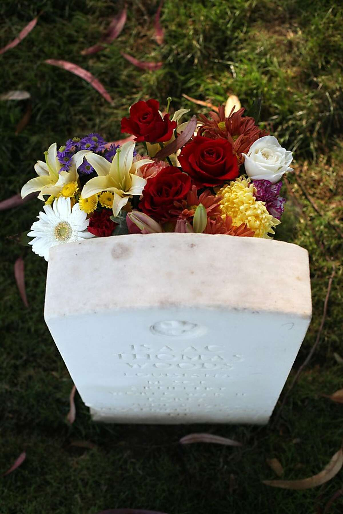 Flowers are seen on the grave of Isaac Thomas Woods in San Francisco National Cemetery on October 2, 2013 in San Francisco, Calif.