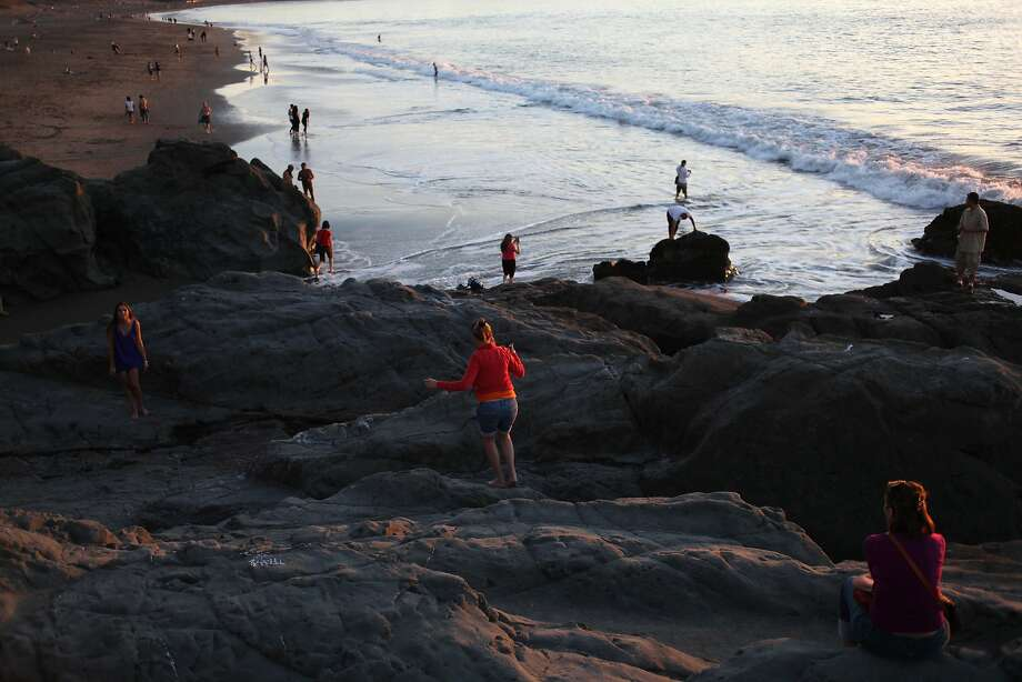 Visitors take in the sunset at Baker Beach in San Francisco, which tested poorly in a Natural Resources Defense Council report on bacteria. Photo: Pete Kiehart, The Chronicle