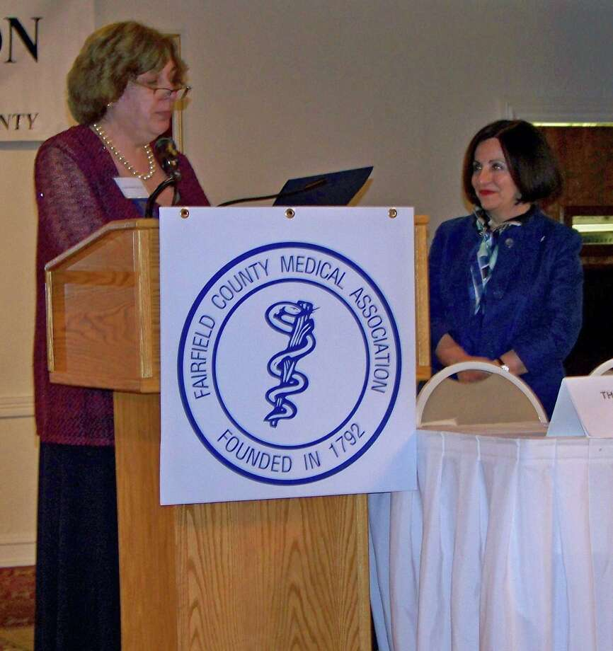 Dr. Robin Oshman, president of the Fairfield County Medical Association, presents state Sen. Toni Boucher, R-26, with the Legislator of the Year Award. Photo: Contributed Photo, Contributed / Darien News