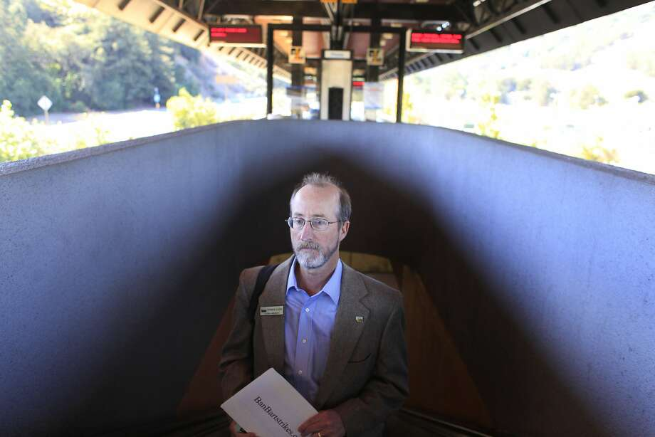 Riding the escalator to the Orinda station platform, Orinda City Council member and banBARTstrikes.com organizer Steve Glazer prepares to start his campaign to ban transit strikes in California by riding to all 44 BART stops on Monday, October 14, 2013 in Monday Oct. 14, 2013 in Orinda, Calif. Photo: Mike Kepka, The Chronicle