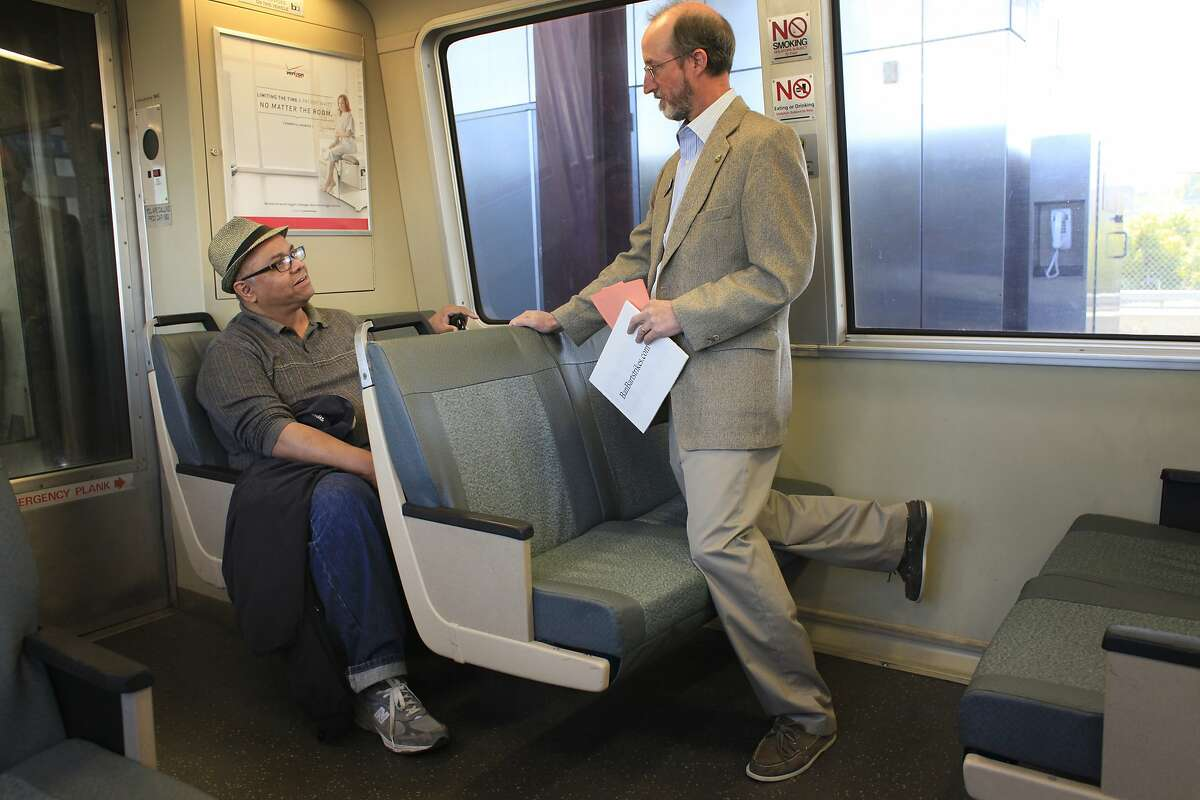 Talking to regular BART rider Frank Gonzalez, of Pittsburg, Orinda City Council member and banBARTstrikes.com organizer Steve Glazer campaigns to ban transit strikes in California by riding to all 44 BART stops on Monday, October 14, 2013 in Monday Oct. 14, 2013 in Orinda, Calif.