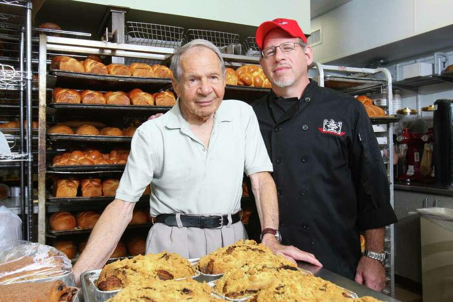 Sigmund Jucker, 91, left, is proud that son Bobby took over Three Brothers Bakery, a business started by the elder Jucker and two siblings in 1949 on Holman Street. The bakery now has locations at 4036 S. Braeswood and in Memorial at 12393 Kingsride Lane. It is planning to open another  on Washington Avenue. Photo: Matthew White, Freelance / Freelance