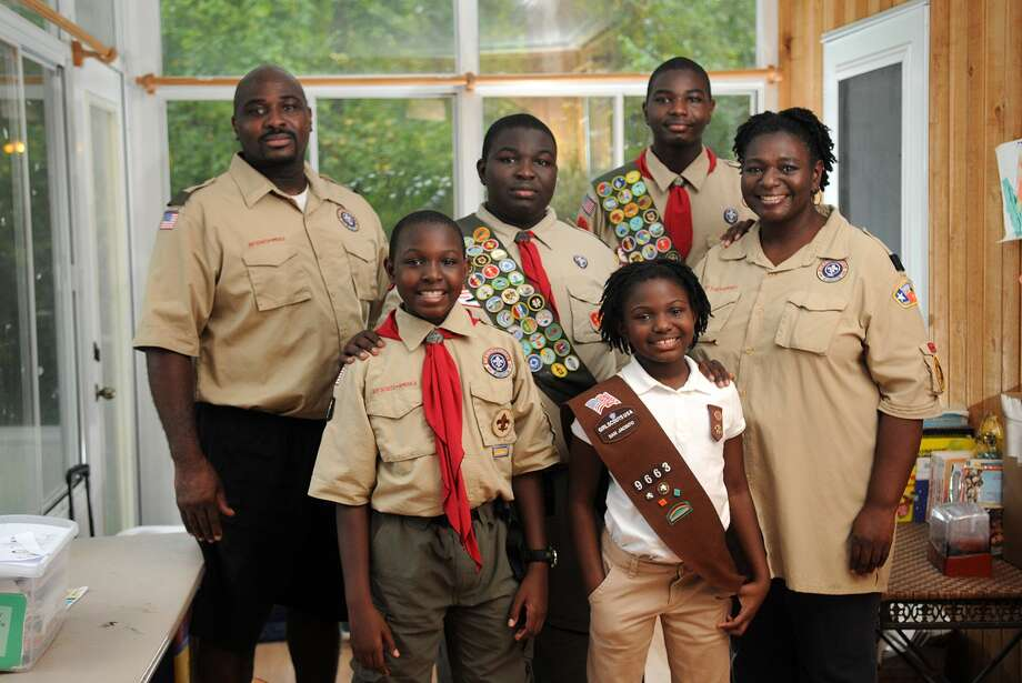 The Thomas family, including Roger Thomas II, from left, Robert Thomas, 10, Russell Thomas, 14,  Ryleigh Thomas, 7 , Raymond Thomas, 16, and Tauleece Thomas, as well as Roger Thomas III, not pictured, are Scouts all the way. Photo: Jerry Baker, Freelance
