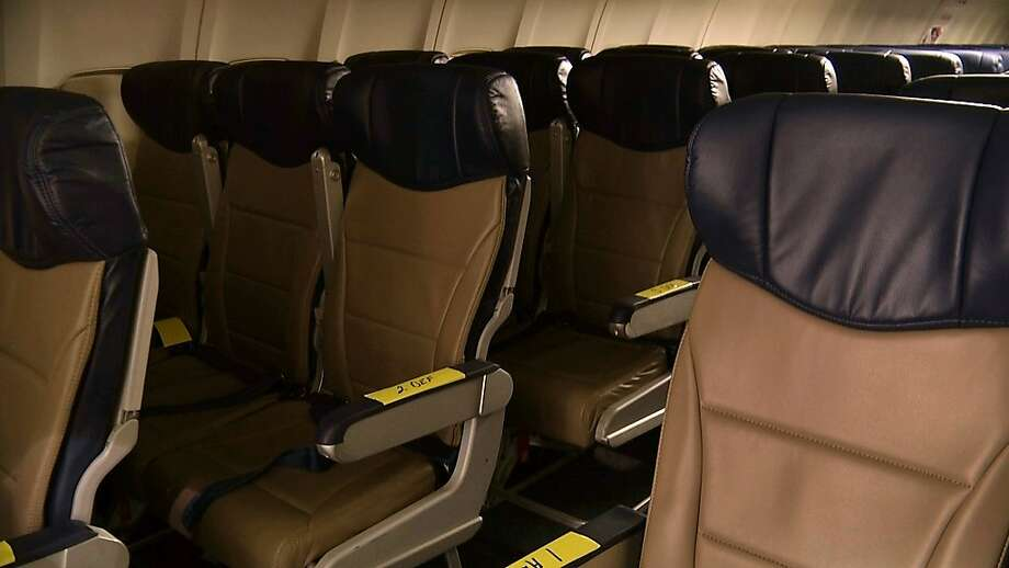 In this Sept. 23, 2013 photo, rows of slimline seats await installation onboard a Southwest Airlines 737 at the carrier's headquarters in Dallas. Southwest says passengers will have the same amount of legroom even though the new seats allow for another row onboard. (AP Photo/John Mone) Photo: John Mone, Associated Press