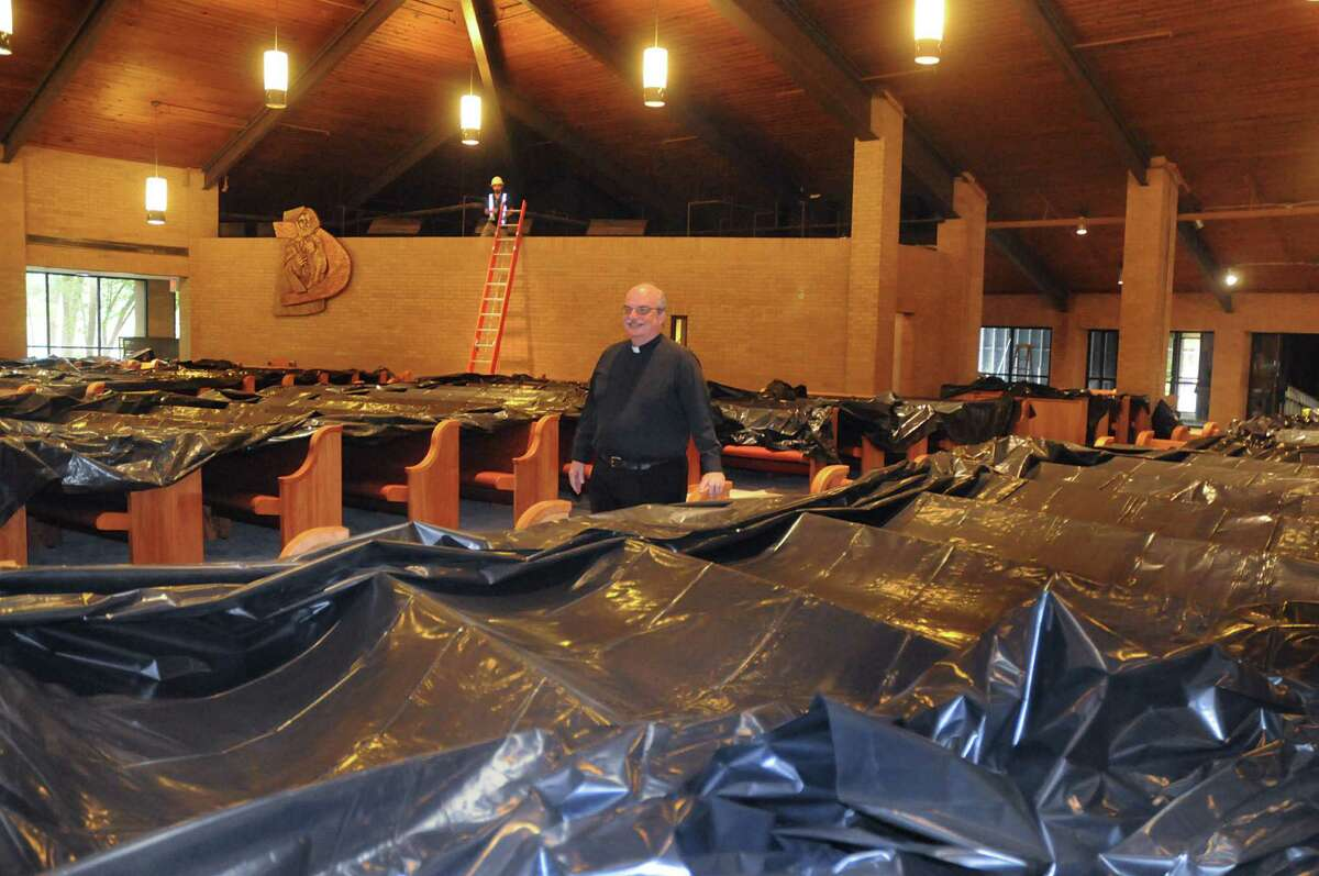 Father Pat Garrett looks over the renovations in the the sanctuary at Sts. Simon and Jude Catholic Parish, 26777 Glen Loch Drive. Renovation on the Parish is almost complete. Photo by David Hopper