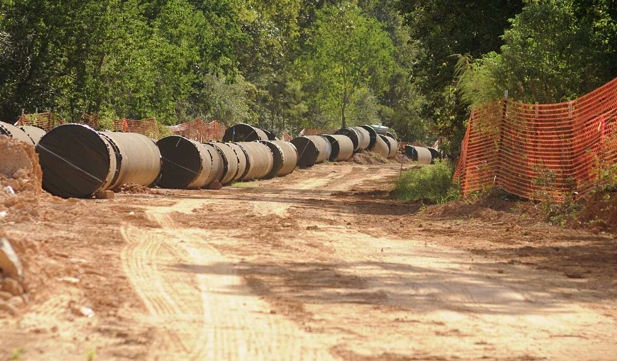 Pipeline waits to be installed along Research Forest. Construction on the new water pipeline running along Research Forest has traffic being diverted to one lane of traffic at different locations. Photo by David Hopper