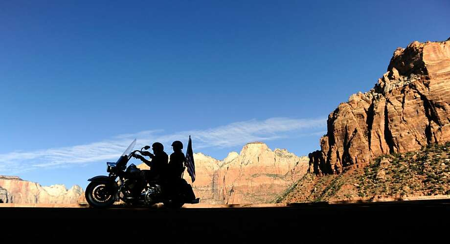 Park and rev:Bikers cruise through reopened Zion National Park in Springdale, Utah. Unlike California, Utah is   using its own money to reopen eight national parks and monuments. Photo: David Becker, Getty Images